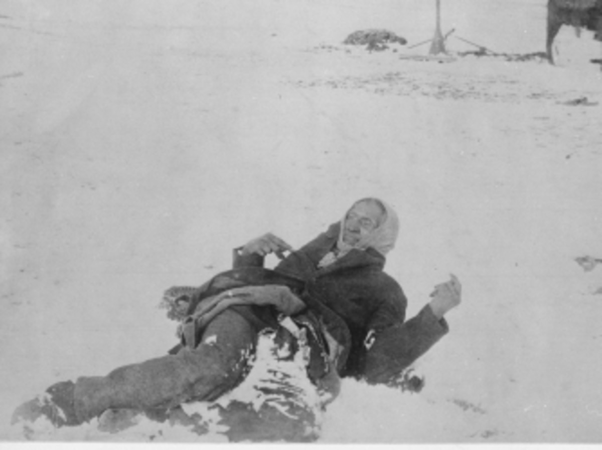 Big Foot, leader of the Sioux, lying in the snow where he was killed during the Wounded Knee Massacre.