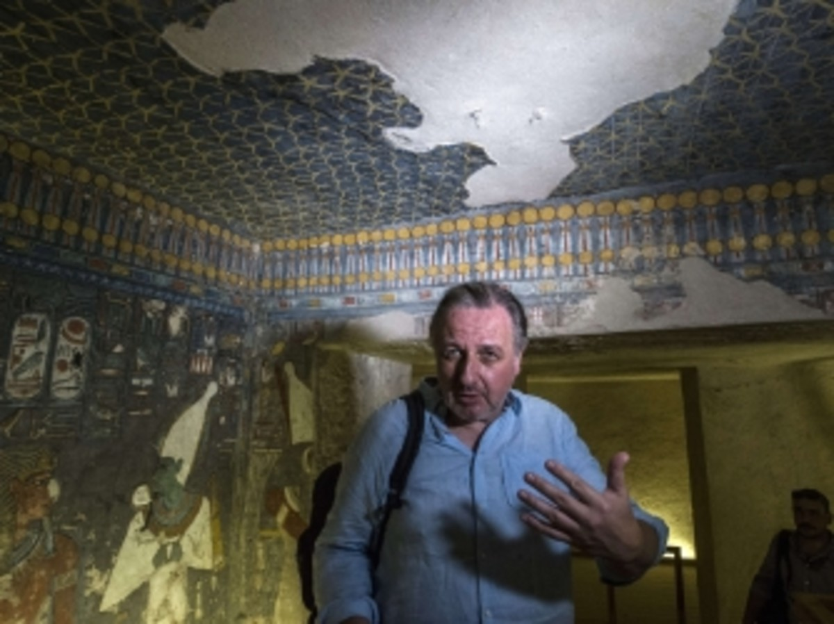 Egyptologist Nicholas Reeves speaking to journalists during a visit to Tutankhamen's tomb.