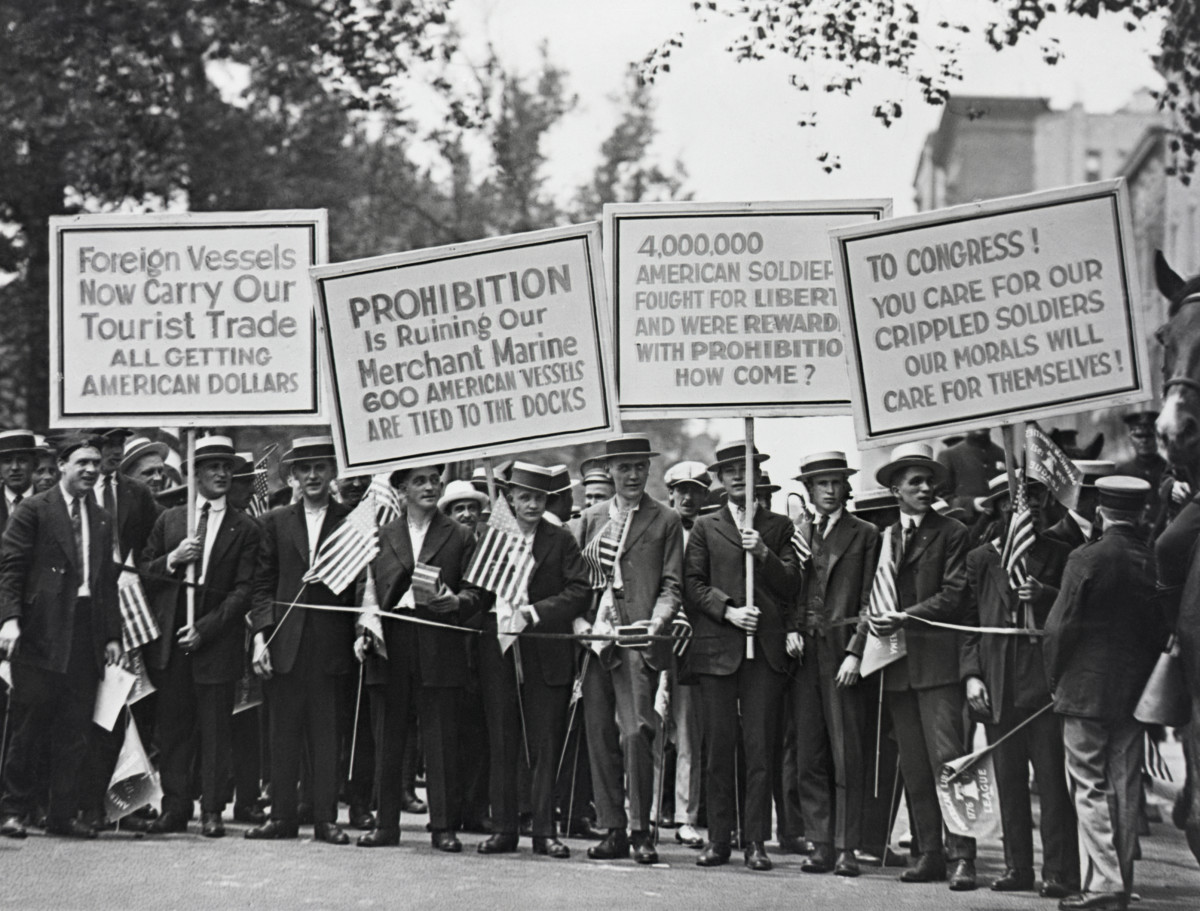 Protesters carrying signs about the negative effects of prohibition.