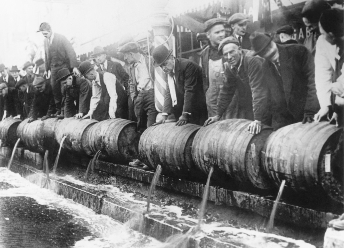 Barrels of beer emptied into the sewer by authorities during prohibition.
