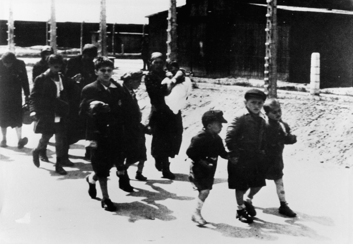 Jewish children from Paris caught by the police before being deported to a camp in 1942.