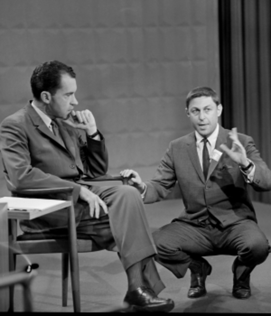 Producer Don Hewitt of CBS News speaks with Vice President Richard Nixon on the set of the first televised debate.