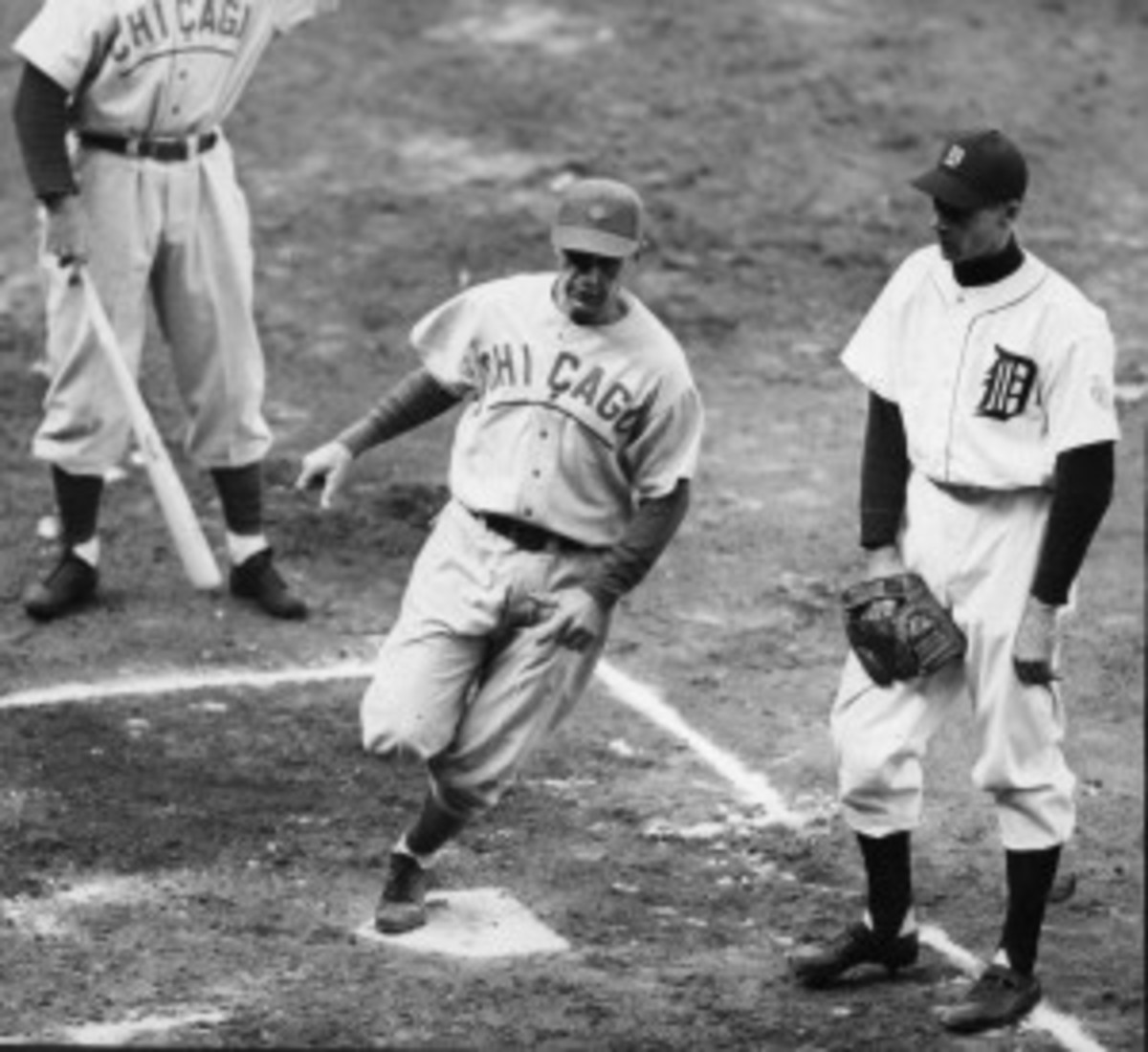 1945 World Series between the Detroit Tigers and Chicago Cubs. Cubs Don Johnson scores.