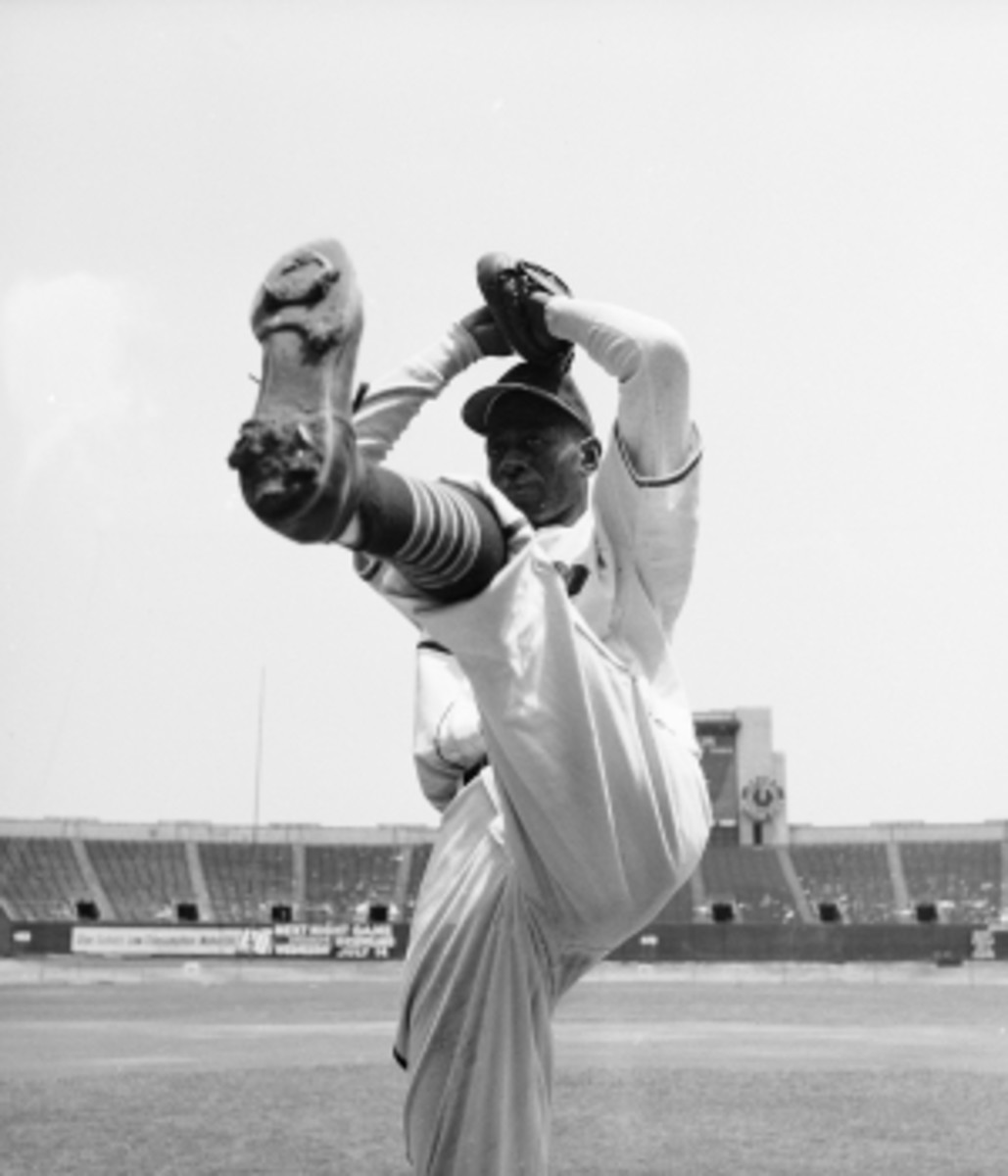 Pitcher Satchel Paige in his wind up.