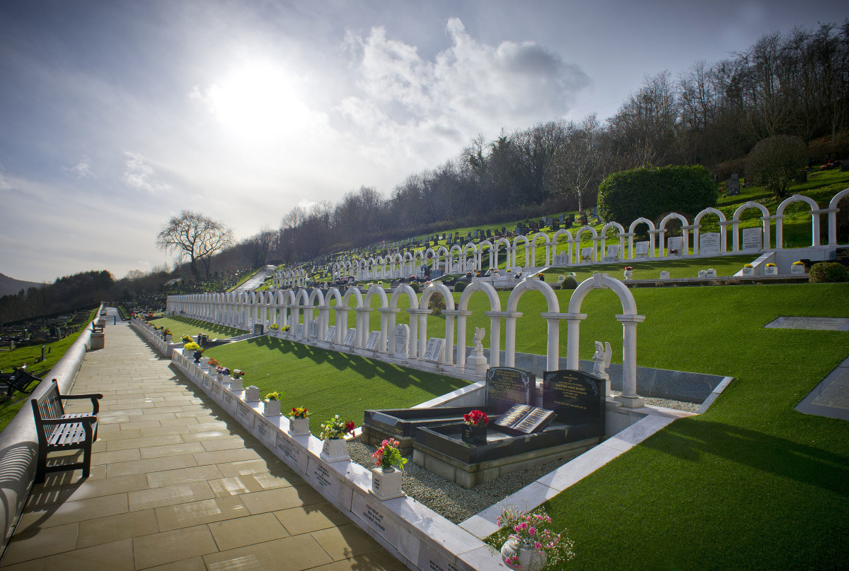 Two rows of white arches near the top of Aberfan cemetery, as seen here in 2016, mark the graves of the children killed in the colliery tip disaster of 1966.