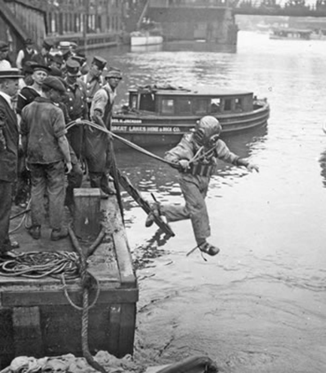 A rescue worker leaps into the Chicago River.
