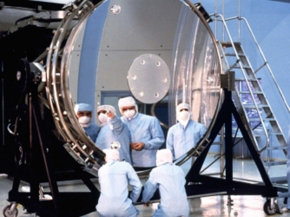 Workers study Hubble's main mirror.
