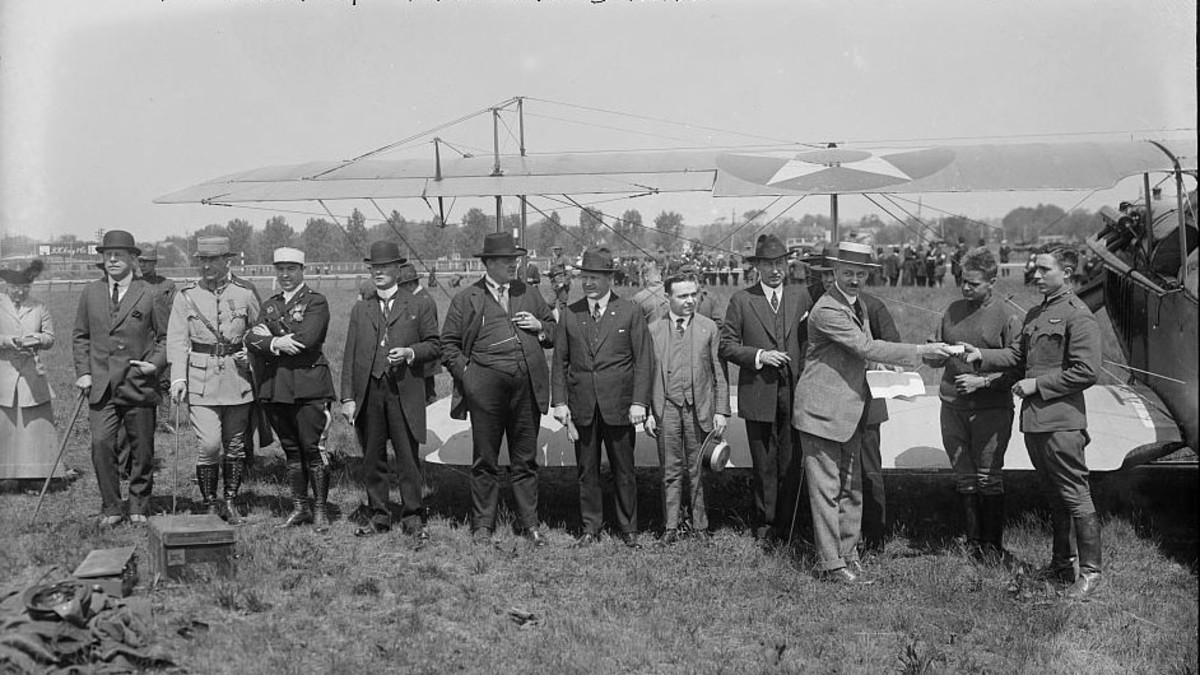 Henry Woodhouse, seventh from the left, seen on May 15, 1918 as one of the first regularly scheduled airmail flights in the United States took place.