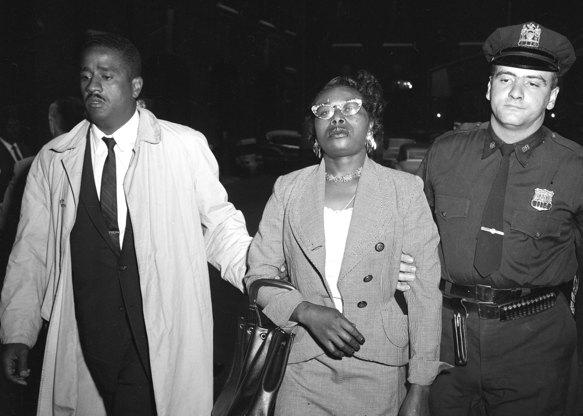 Police officers arresting Izola Curry after stabbing Martin Luther King, Jr. with a letter opener.
