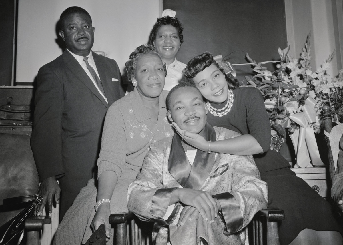Martin Luther King comforted by his wife Coretta and others in the hospital during rec