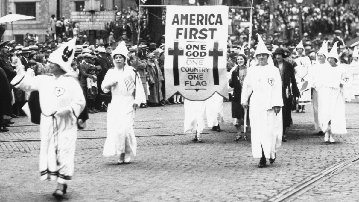 "Ku Klux Klan staging an ""America First"" parade in Binghamton, NY in the 1920s."