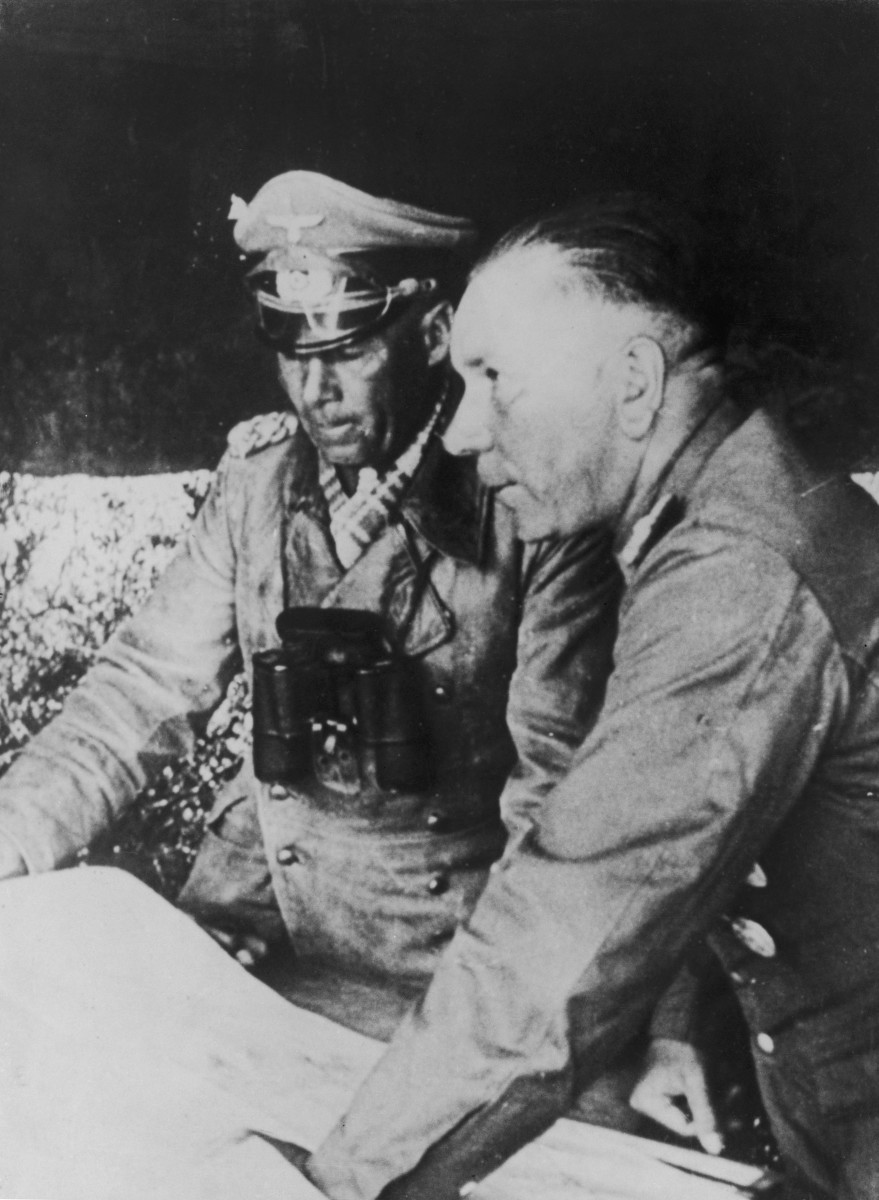 German military commander Erwin Rommel discussing plans with General Nehring in Tunisia in December 1942.