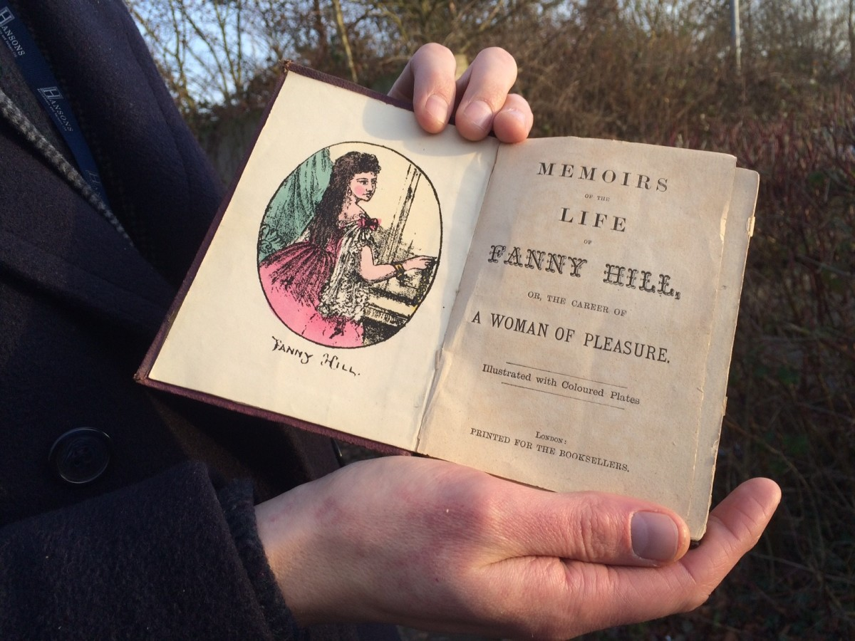 Jim Spencer holding book-Fanny Hill-credit Hansons