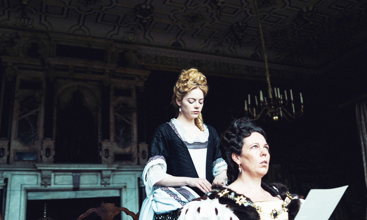 Emma Stone, as Abigail, and Olivia Colman as Queen Anne in 'The Favourite'.