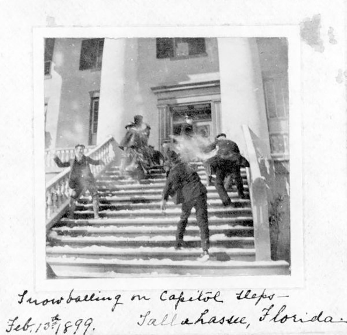 A snowball fight on the steps of the Capitol in Tallahassee, Florida in 1899.