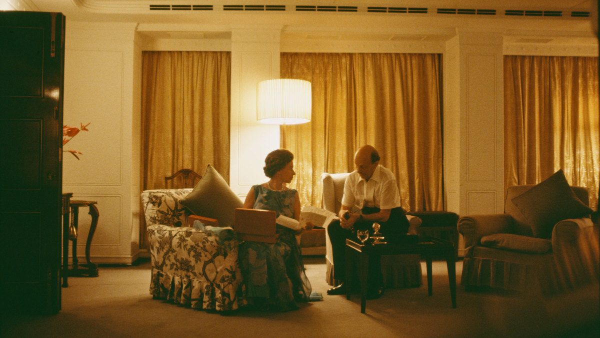 Queen Elizabeth II and her Private Secretary Sir Martin Charteris reviewing papers late at night on board the Britannia, 1972.