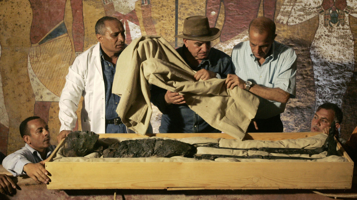 The removal of the linen-wrapped mummy of King Tutankhamun from his stone sarcophagus in his underground tomb in the famed Valley of the Kings in Luxor, on November 4, 2007.
