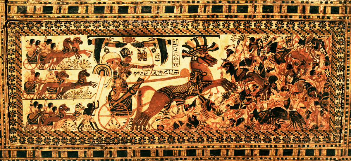 Side of the painted casket from the tomb of Tutankhamun, depiciting the King in battle in a chariot.