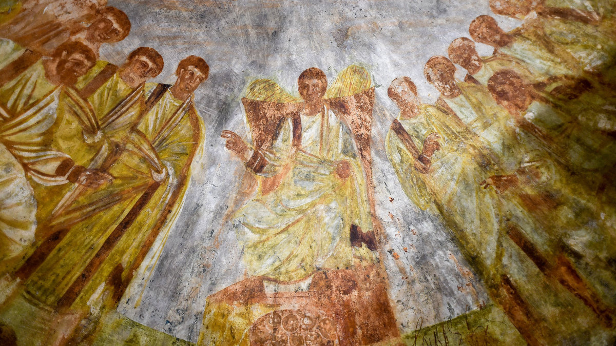 The restored fresco depicting Jesus and his apostles in the Roman catacomb of Santa Domitilla.