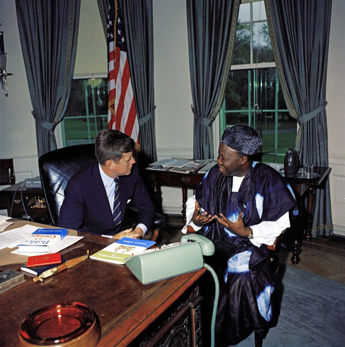 President John F. Kennedy meets with Dr. William H. Fitzjohn, Charge d'Affairs of Sierra Leone, in the Oval Office on April 27, 1961.
