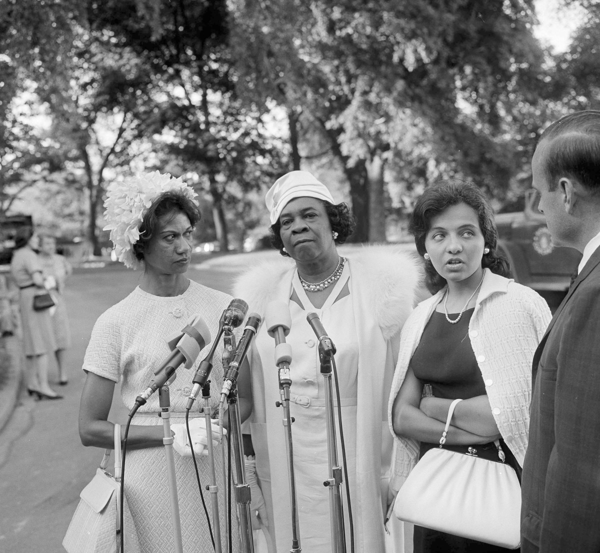 Gloria Richardson, Dr. Rosa L. Gragg and Diane Nash being interviewed after attending the White House to meet with President John F. Kennedy. He had asked 300 representatives of Women's organizations to back his civil rights program to help solve the racial problems.