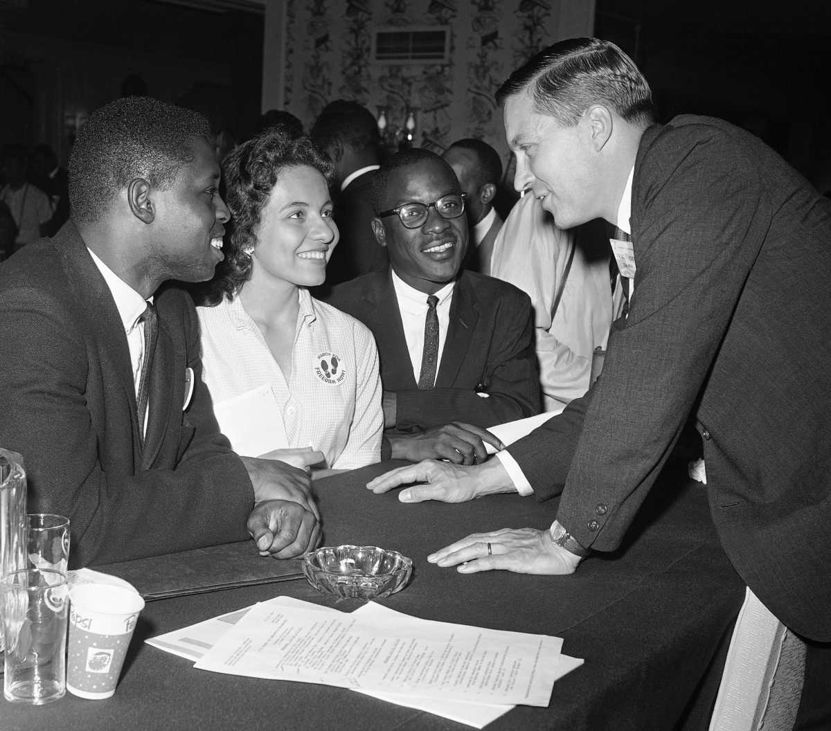 Charles H. Percy, right, chairman of the platform committee of the Republican Party, speaking with Walter Bradford, Diane Nash, and Bernard Lee on July 20, 1960.