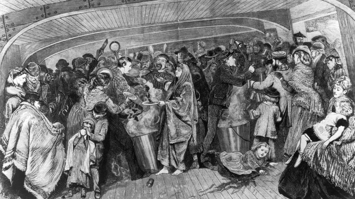 Immigrants taking a meal aboard a crowded ship bound for America, circa 1870s.