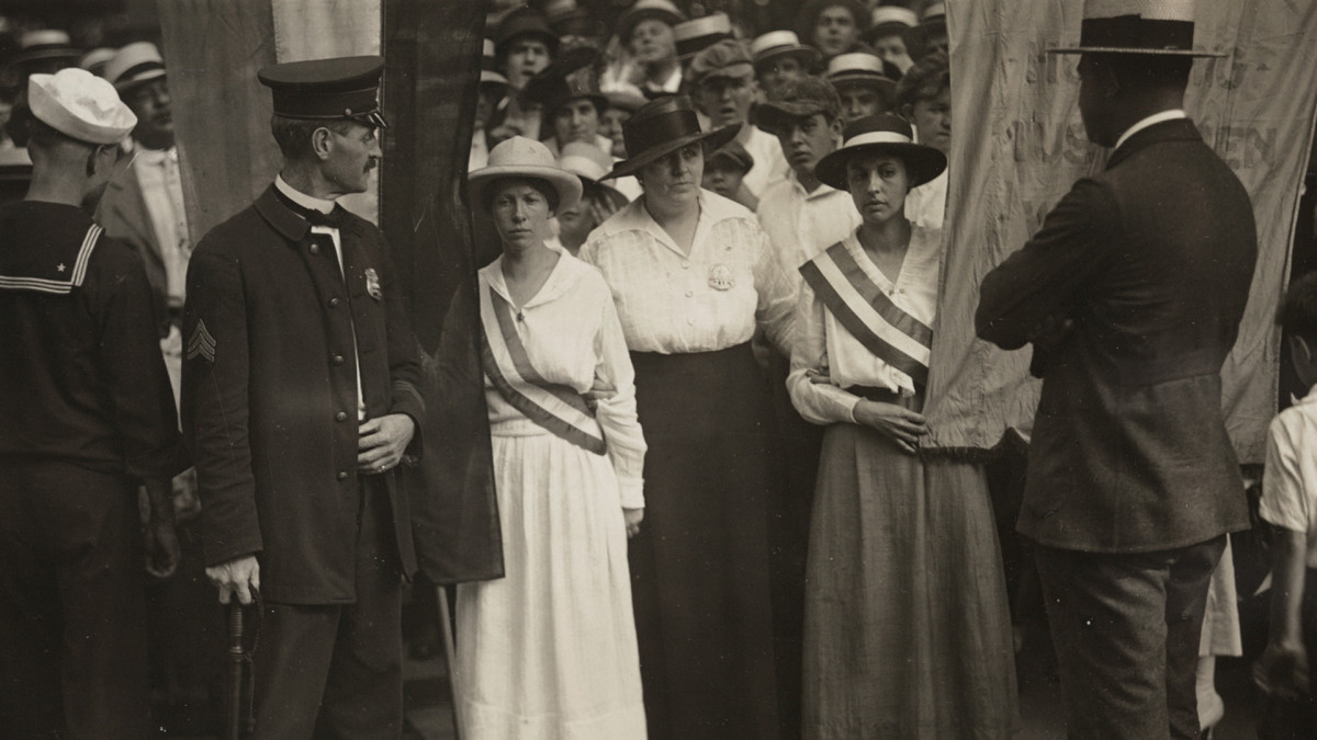 National Woman's Party members being arrested as they picket with banners before the White House East Gate, in August 1917.