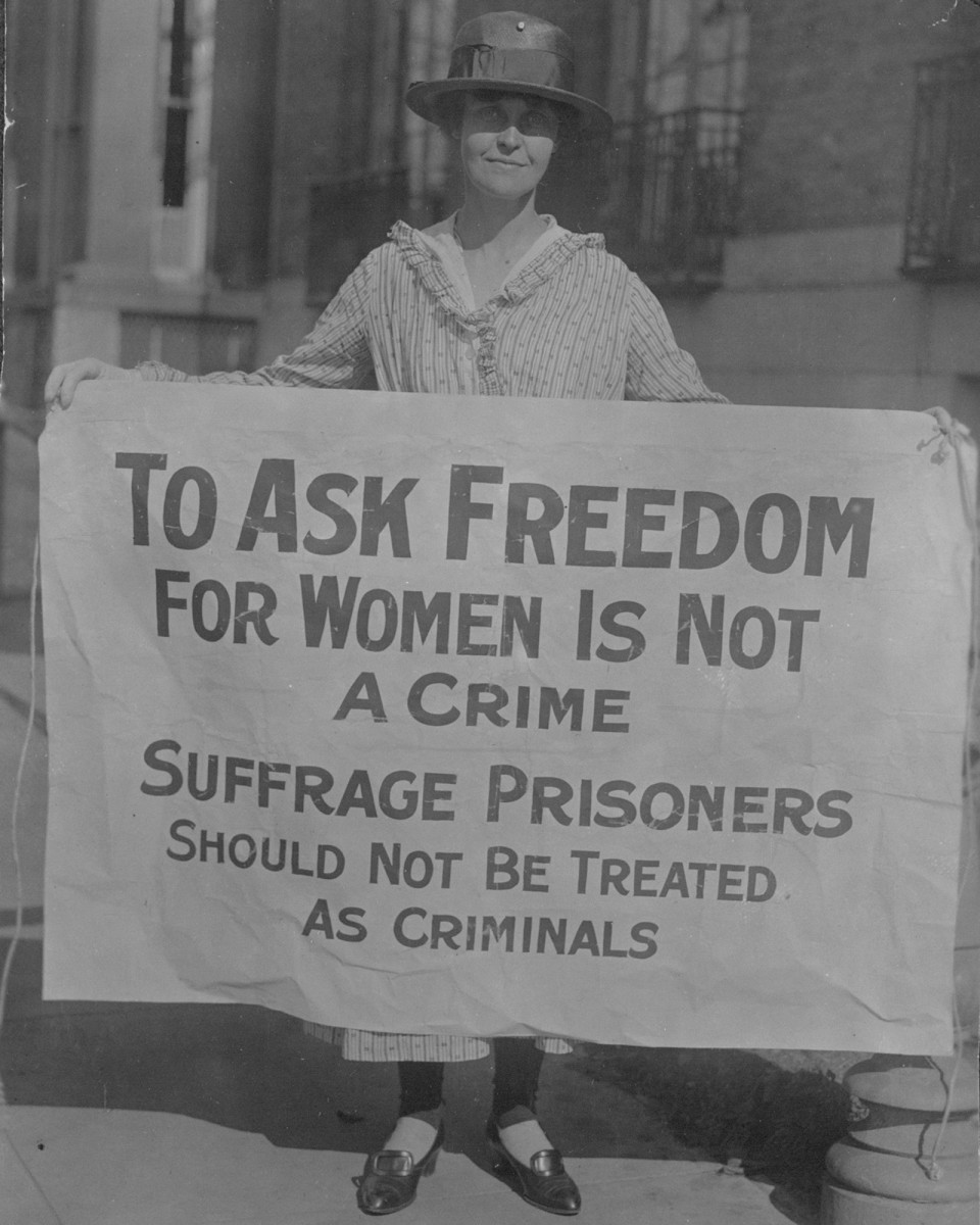 "Suffragist Mary Winsor holding a banner that reads: ""To Ask Freedom for Women is Not a Crime. Suffrage Prisoners Should Not be Treated as Criminals,"" circa November 1917."