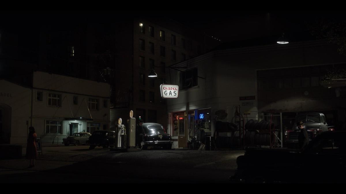 The dramatic lighting in this gas station scene shows the influence of painter Edward Hopper, says production designer Ross Dempster.  CREDIT: Eduardo Araquel/HISTORY.