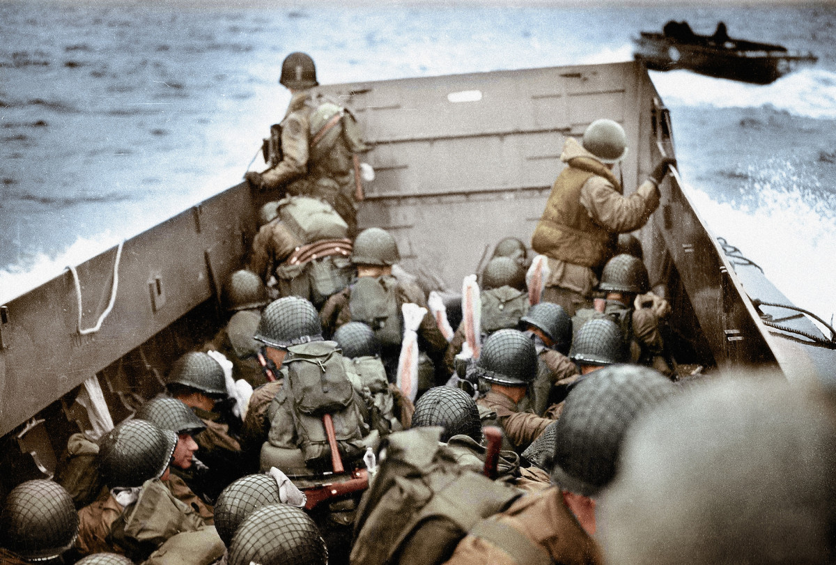 U.S. Army infantry men approaching Omaha Beach, Normandy, France on June 6, 1944.