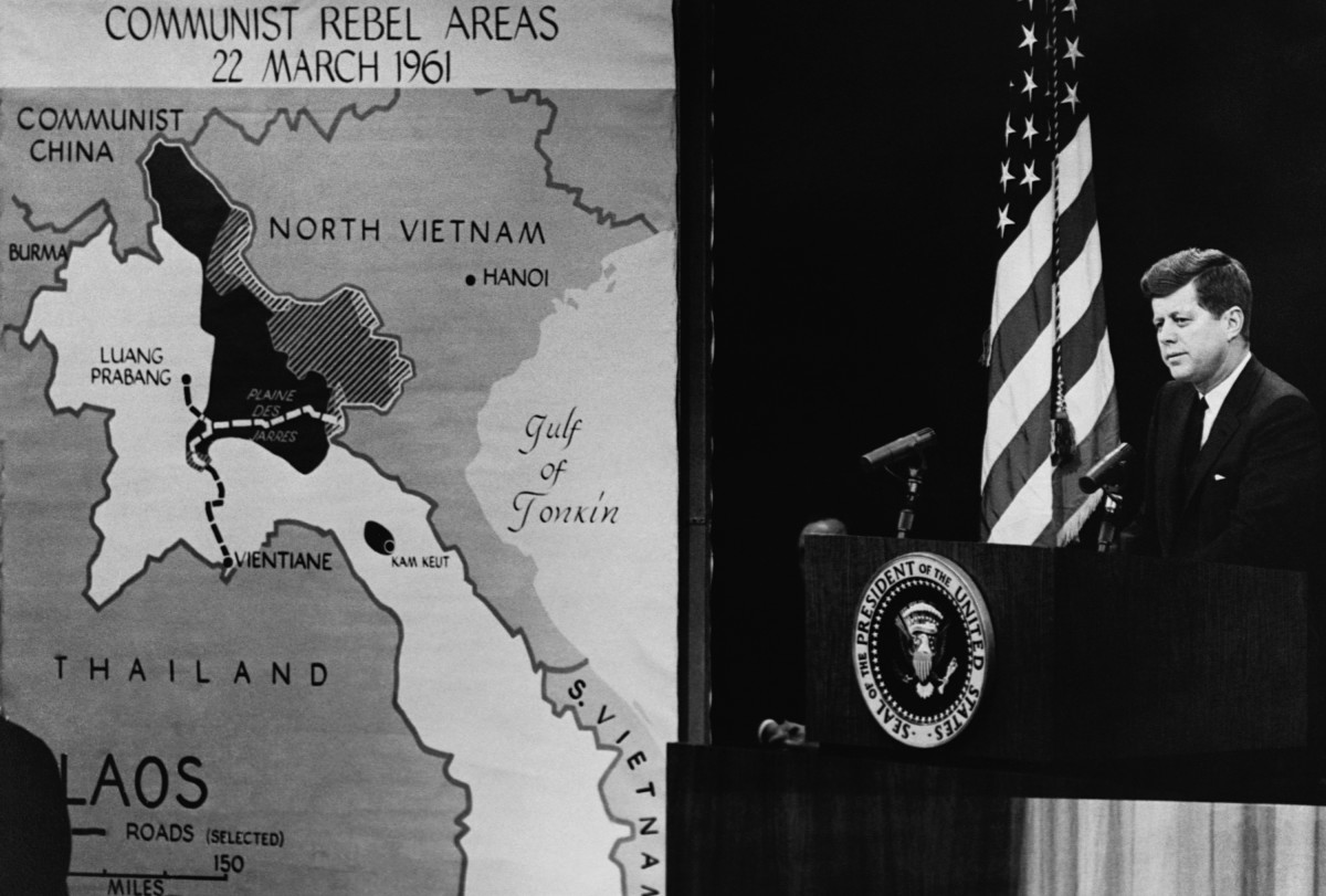 President John F. Kennedy gives a press conference on the situation in Southeast Asia, showing the areas held by communist rebels.