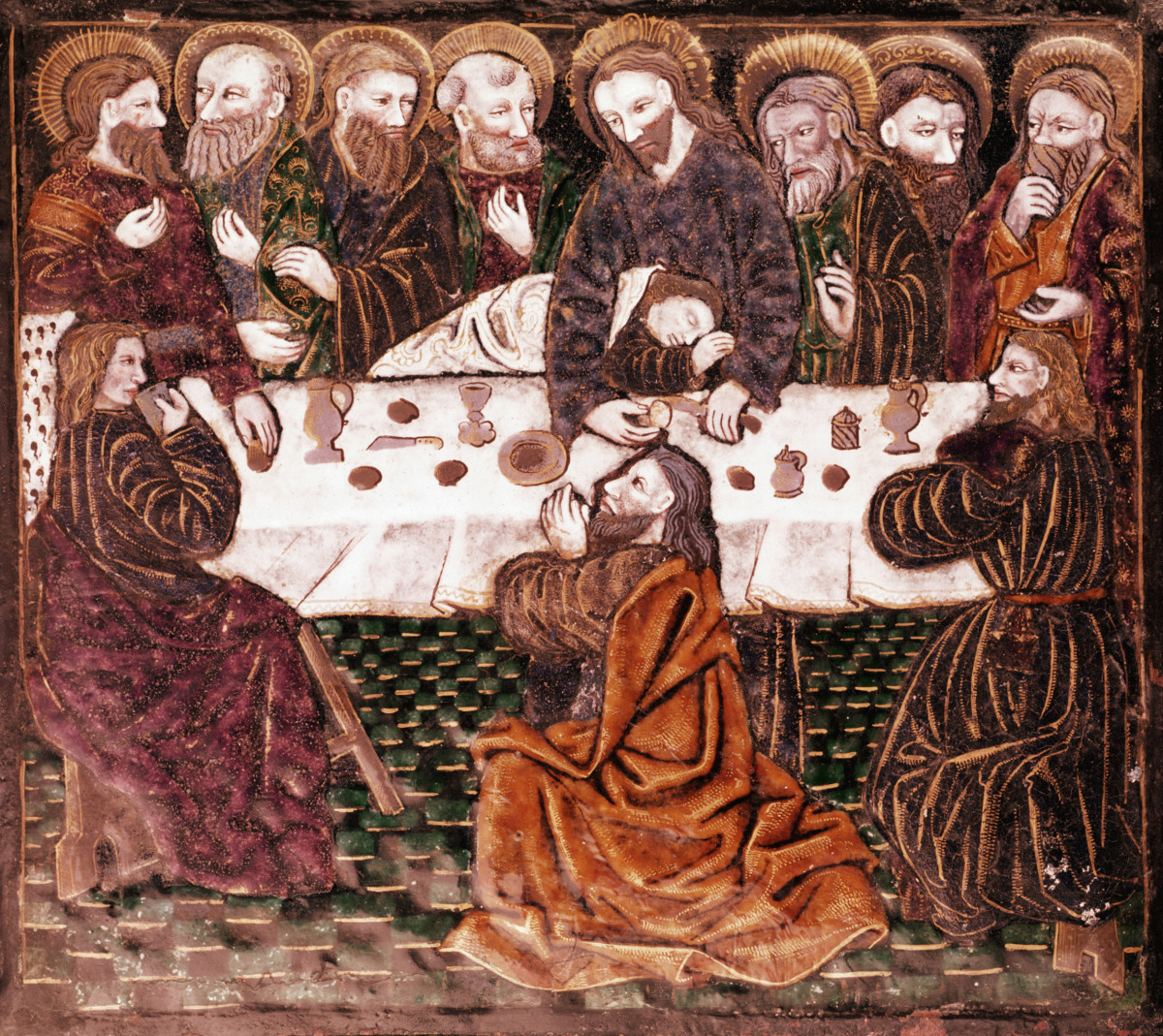 Jesus made an announcement of betrayal at the Last Supper. Judas is seen seated at the opposite side of the table.