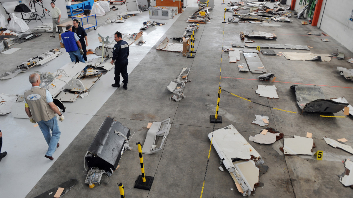 Investigators look through debris from the mid-Atlantic crash of Air France flight 447 on July 24, 2009 at the CEAT aeronautical laboratory in Toulouse, France. The Air France flight from Rio to Paris came down during the night of May 31 to June 1, 2009 during a storm, with the loss of all 228 people on board.