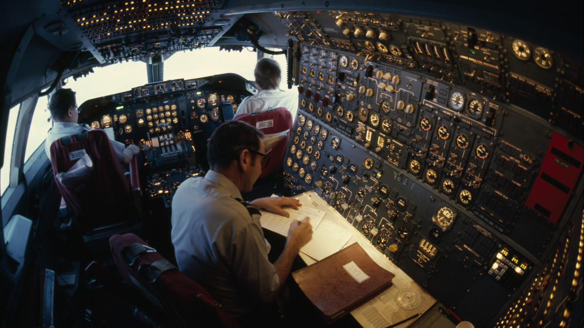 Pilots let autopilot take control en route to Anchorage, Alaska, above North America circa 1977.