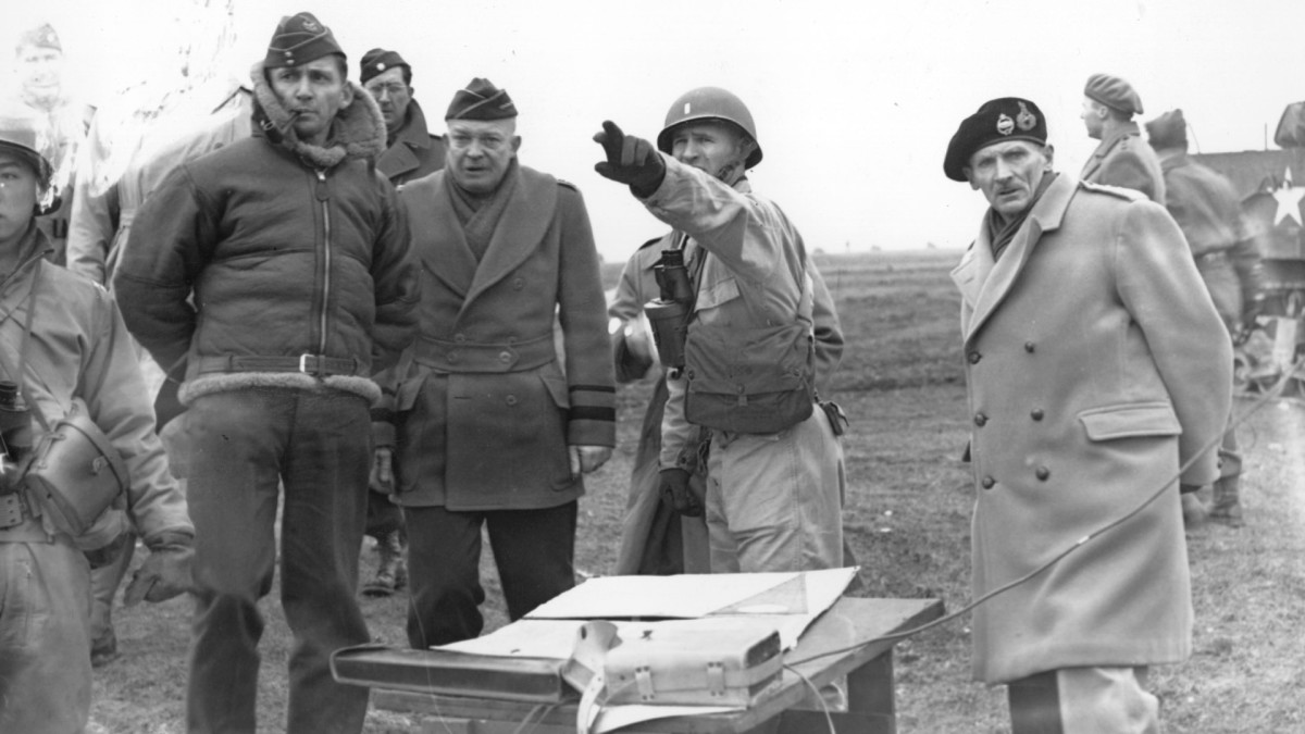 Allied Chiefs Air Marshal Arthur Tedder, General Dwight D Eisenhower, and Field Marshall Bernard L. Montgomery, watch tank maneuvers on February 25, 1944 in preparation for the D-Day landings.