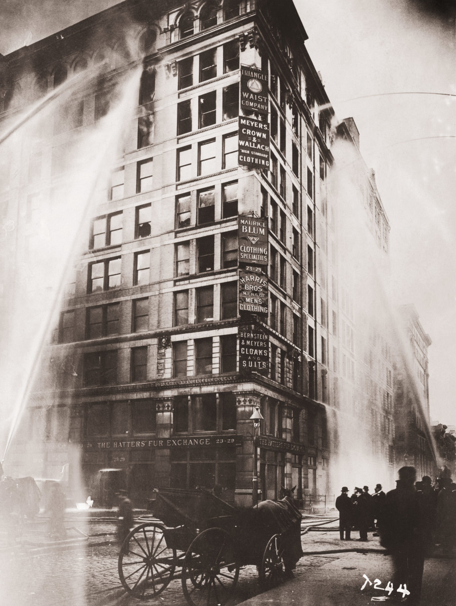 Fire hoses spray water on the upper floors of the Asch Building, housing the Triangle Shirtwaist Company, on Washington and Greene Streets in New York City, during the fire on March 25, 1911.