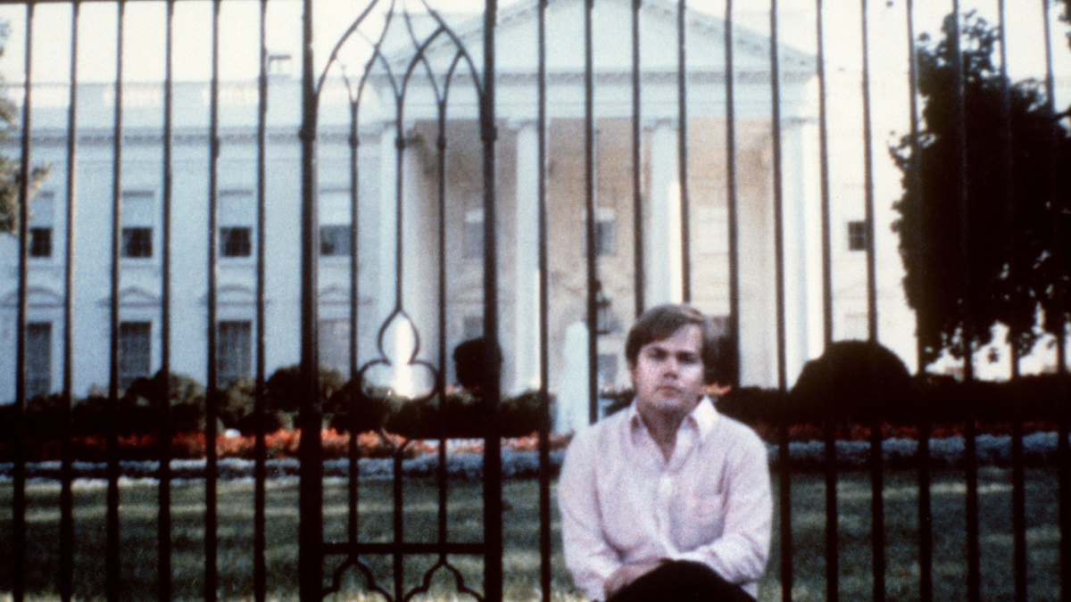 A photo of John Hinckley taken in front of the White House, 1981.