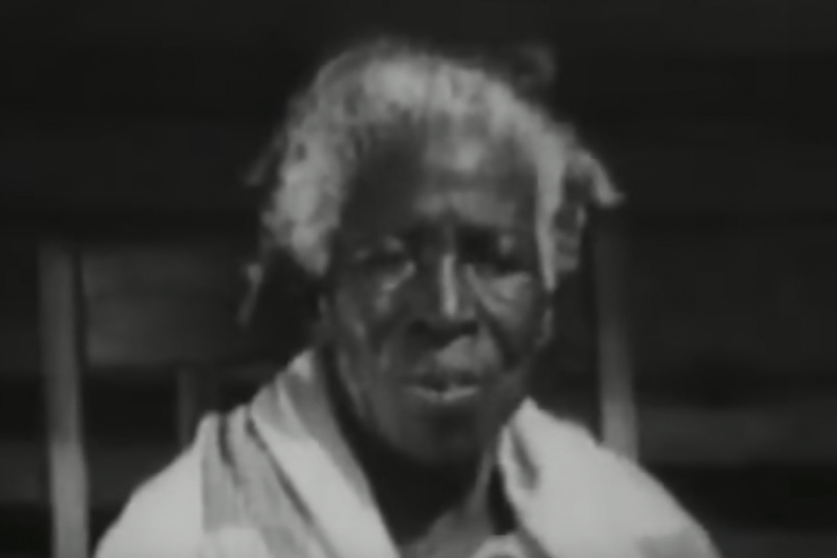 "Redoshi known as Sally Smith after becoming enslaved, in an instructional film released by the Department of Agriculture in 1938 called ""The Negro Farmer: Extension Work for Better Farming and Better Living."""