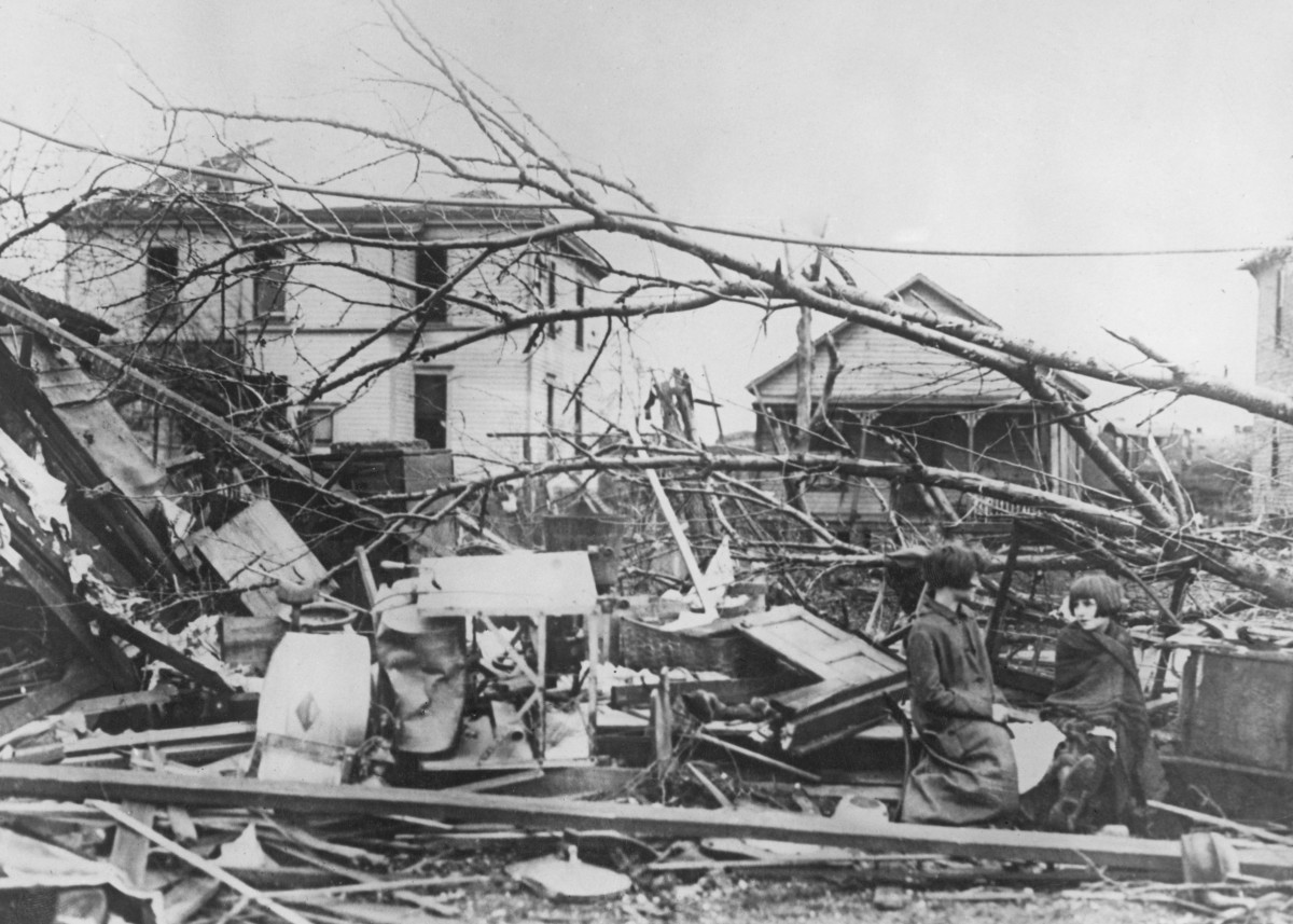 Sisters Minnie and Rose Hawkins sit amongst the wreckage of their home in Murphysboro, Illinois, in the wake of the 1925 tri-state tornado.