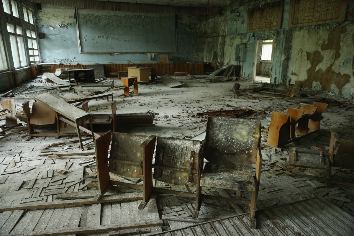 Students chairs stand on rotting floorboards in an auditorium of an abandoned school on September 30, 2015 in Pripyat, Ukraine. The city lies in the inner exclusion zone around Chernobyl where hot spots of persistently high levels of radiation make the area uninhabitable for thousands of years to come.