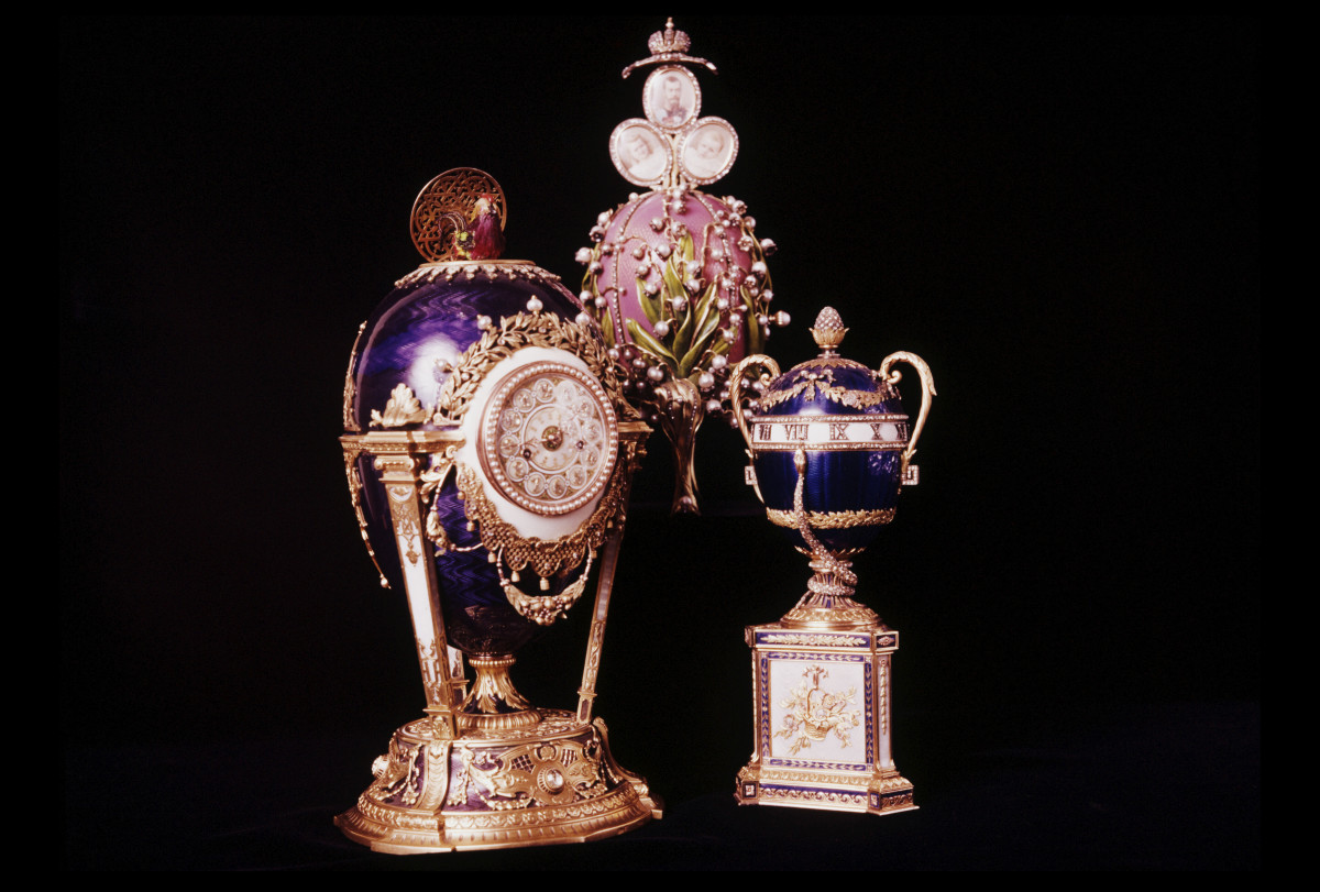 Three additional Fabergé eggs created for the Russian imperial family: (L-R) the Cuckoo Clock Egg or Cockerel Egg, the Lilies of the Valley Egg, and the Blue Serpent Clock Egg.