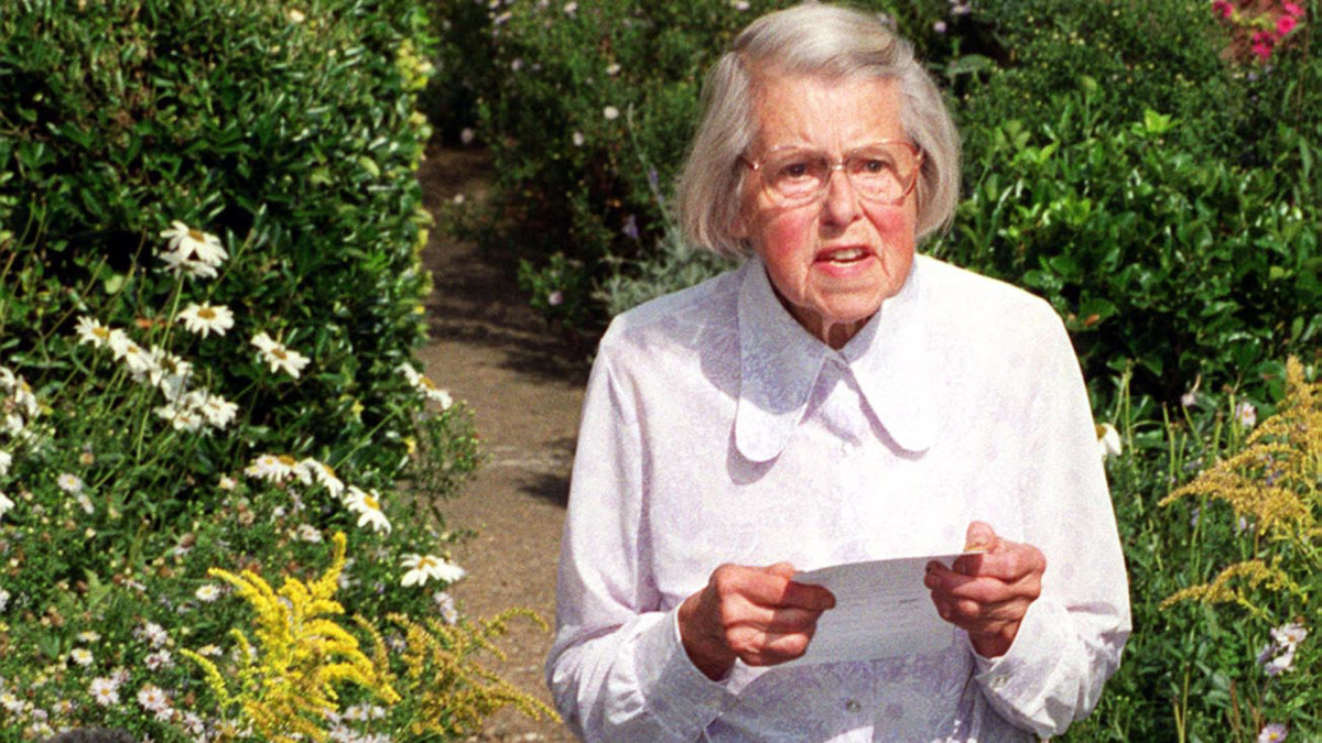 Melita Norwood, pictured here at age 87 in 1999, standing outside her home in Bexleyheath, where she reads a statement to the press concerning her involvement in passing over atomic secrets to the KGB.