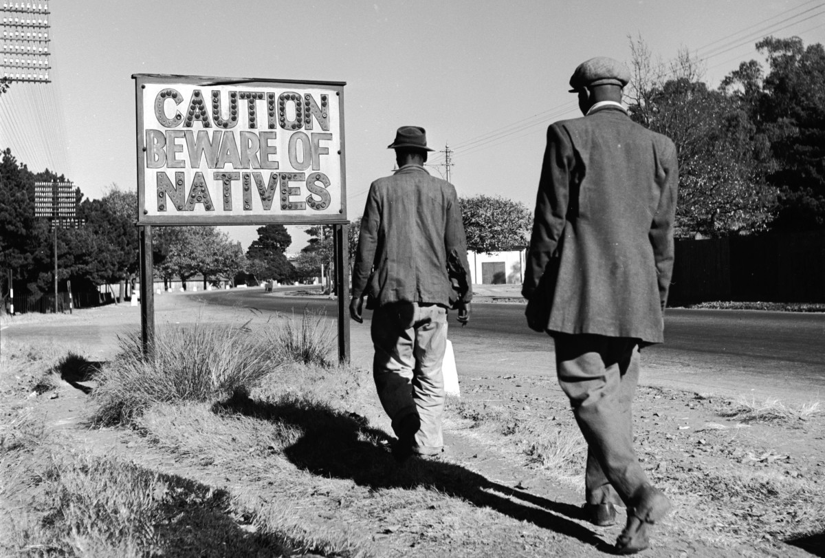 A sign common in Johannesburg, South Africa, reading 'Caution Beware Of Natives'.