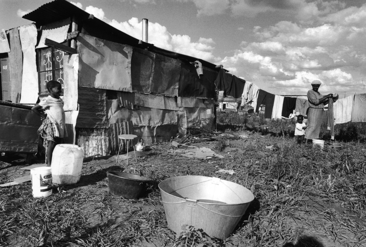 A South African family moved from Soweto to the Orange Farm shantytown in South Africa, December 1989.