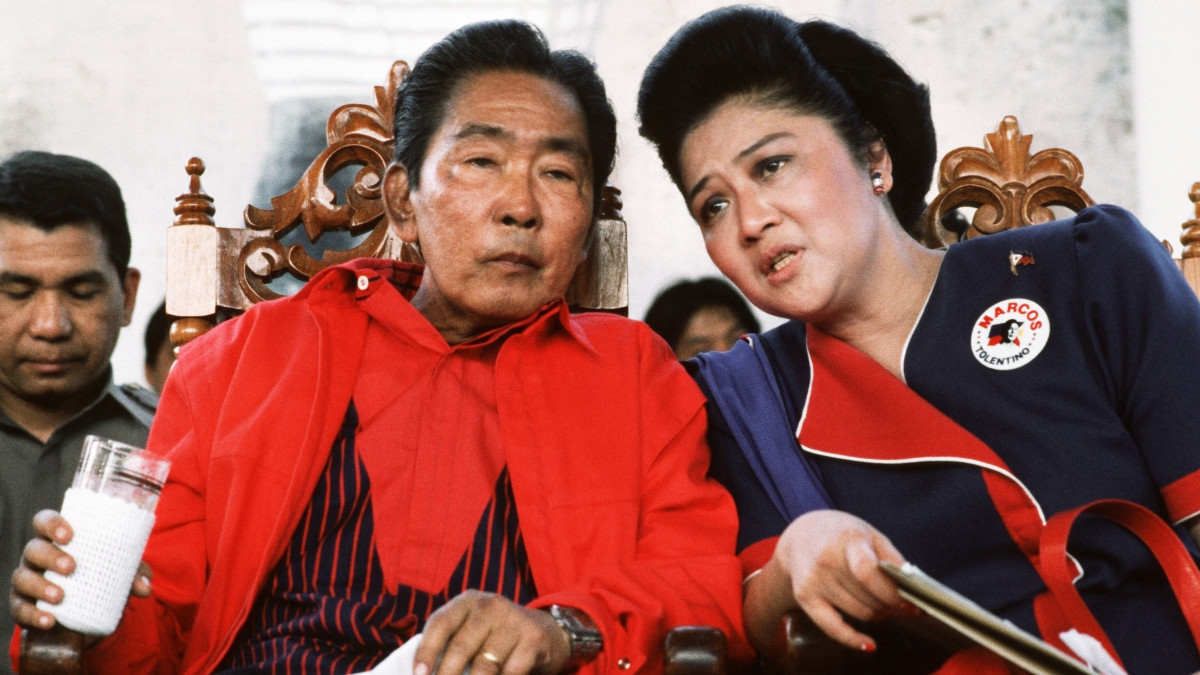 "President Ferdinand Marcos and First Lady Imelda Marcos at a rally prior to the ""People's Power"" revolution that finally saw him ousted as President of the Philippines. On February 25th 1986 he and the First Lady, Imelda fled the country with their family."