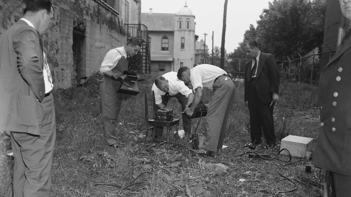 New York City police were sent to Union City, New Jersey on July 13, 1940 to examine a mysterious black box found the day before at the Jewish community center and believed to be a bomb Police are shown examining the package to the bomb explosion on July 4 at the world fair.