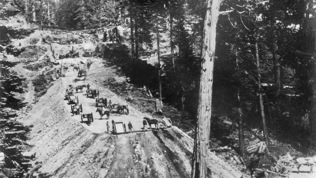 Chinese workers building a cut and a bank at Sailor's Spur in the Sierra foothills for the Central Pacific Railroad in California, 1866.