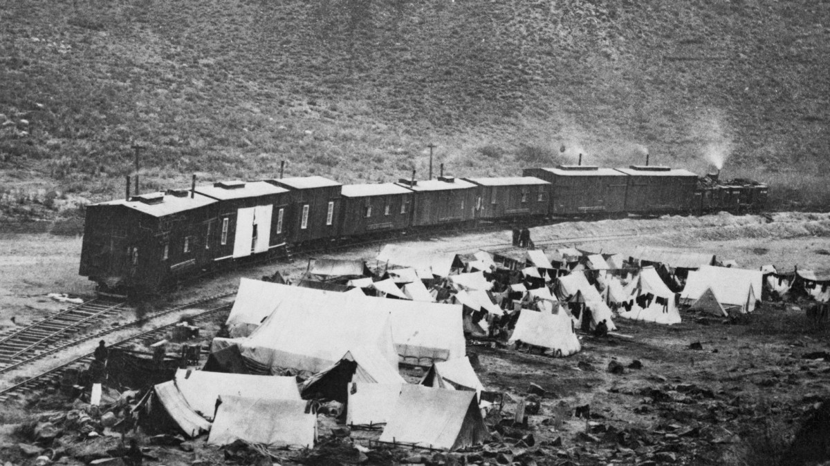 Chinese camp and construction train in Nevada when building of the first transcontinental railroad was being speeded across the state by the Central Pacific.