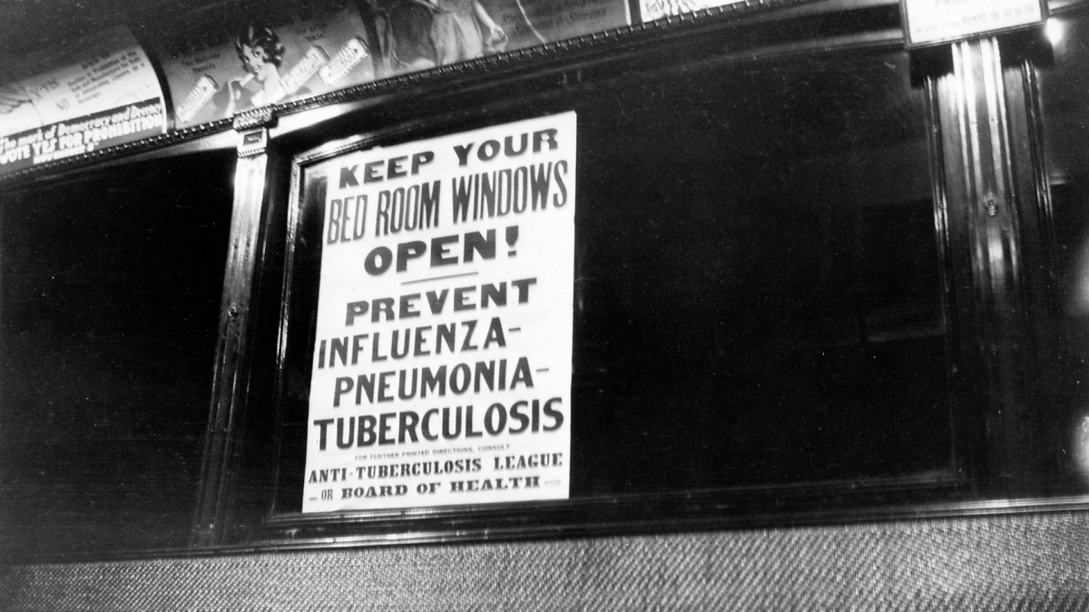 View of a health warning notice about influenza, from the Anti-Tuberculosis League, posted on the inside of a public transport vehicle, 1918 - 1920.